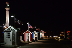 Kiosks on Provincetown Warf & Tower on a Summer night.