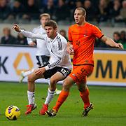 NLD/Amsterdam/20121114 - Vriendschappelijk duel Nederland - Duitsland, Thomas Muller in duel met Ron Vlaar