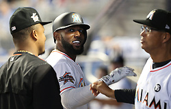 May 31, 2017 - Miami, FL, USA - The Miami Marlins greet left fielder Marcell Ozuna after his two-run home run in the first inning against the Philadelphia Phillies on Wednesday, May 31, 2017 at Marlins Park in Little Havana in Miami, Fla. (Credit Image: © Pedro Portal/TNS via ZUMA Wire)