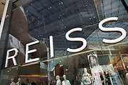 Sign for the high street clothing brand Reiss in Birmingham, United Kingdom.