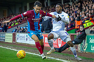 Scunthorpe United midfielder Levi Sutton (22) holds off Wycombe Wanderers midfielder Fred Onyedinma (19) during the EFL Sky Bet League 1 match between Scunthorpe United and Wycombe Wanderers at Glanford Park, Scunthorpe, England on 29 December 2018.