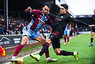 Levi Sutton of Scunthorpe United (22) and Reece James of Sunderland (16) challenge for the ball in the corner during the EFL Sky Bet League 1 match between Scunthorpe United and Sunderland at Glanford Park, Scunthorpe, England on 19 January 2019.