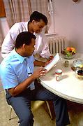 Spouses age 40 going over the family finances.  St Paul  Minnesota USA