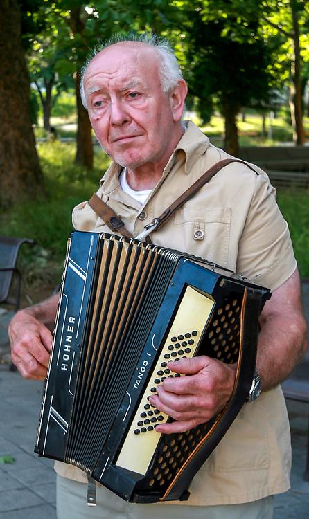 Accordion player near near Karlskirche in Vienna. Photo taken June 28, 2007.
