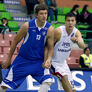 Efes Pilsen's Dusan CANTEKIN (R) and Antalya BSB's Patrick FEMERLING (L) during their Turkish Basketball league match Efes Pilsen between Antalya BSB at the Ayhan Sahenk Arena in Istanbul Turkey on Wednesday 21 April 2010. Photo by Aykut AKICI/TURKPIX
