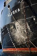 Black ship hull anchored at Port of Seattle