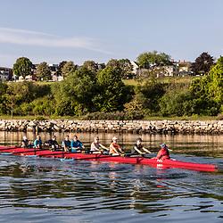 A morning rowing club (Portland Community Rowing Association) rows near the Eastern Promenade in Portland, Maine. Casco Bay.
