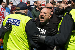 © Licensed to London News Pictures . 03/06/2017 . Liverpool , UK . EDL supporters are held back by police as anti-fascists attempt to break through police lines separating the two sides . Hundreds of police manage a demonstration by the far-right street protest movement , the English Defence League ( EDL ) and an demonstration by opposing anti-fascists , including Unite Against Fascism ( UAF ) . Photo credit: Joel Goodman/LNP