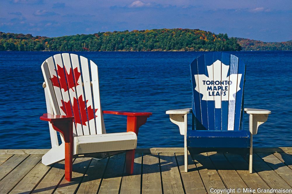 Muskoka chairs on dock at Lake of Bays<br />Near Dorset<br />Ontario<br />Canada