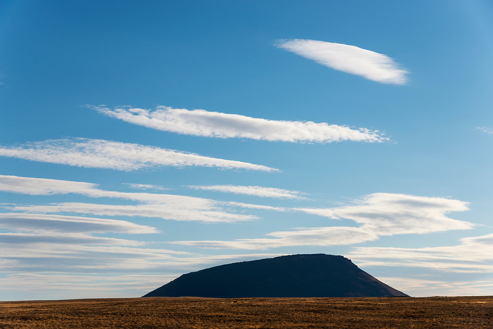 altostratus move across the Idaho Desert Sky near Arco and Howe with inactive volcanos called buttes rising from the desert floor