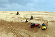 Jeeps, landrovers and All-Terrain Vehicles (ATV) attempt to ruin the peace and quite and the delicate ecosystem on a sand dune. Photographed neae Ashdod, Israel