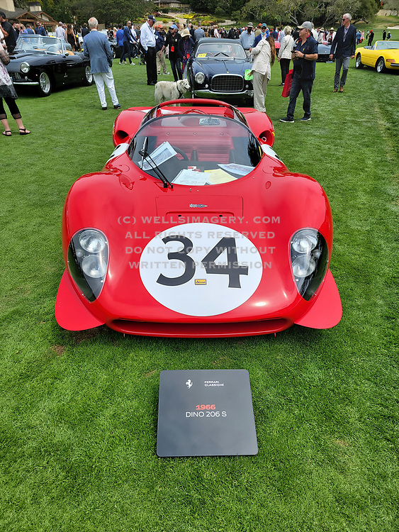 Image of a red 1966 Ferrari Dino 206 S on the lawn at the Pebble Beach Concours d'Elegance in Carmel, California, America west coast by Randy Wells