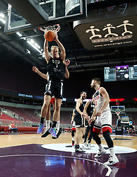 RIGA, Nov. 6, 2019  Roberts Freimanis (L) of VEF Riga controls the ball during the group C match at Europe Basketball Champions League in Riga, Latvia, on Nov. 5, 2019. (Photo by Edijs Palens/Xinhua) (Credit Image: © Edijs Palens/Xinhua via ZUMA Wire)