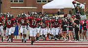 Lindenwood University - Belleville football players take the field before the start of their Homecoming Game as cheerleaders shout encouragement to them.  The Lindenwood Lynx team hosted the Menlo College Oaks.