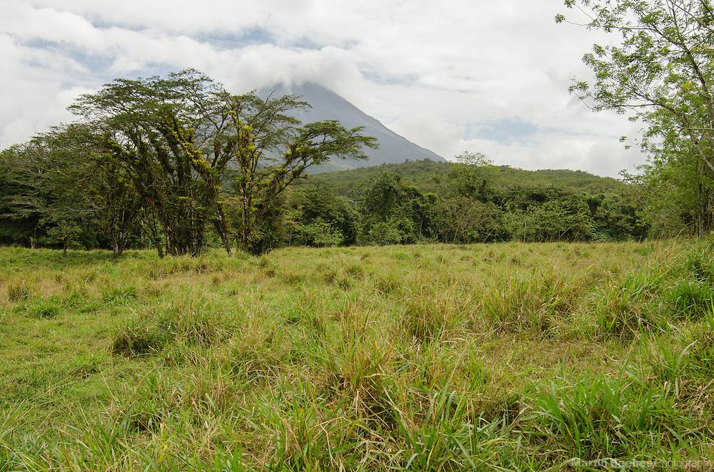 Arenal Volcano shrouded in clouds, near El Castillo, Costa Rica
