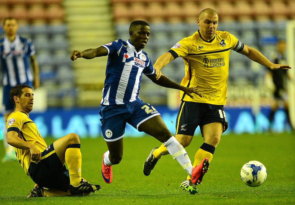 Scunthorpe United's Stephen Dawson vies for possession with Wigan Athletic's Francisco Junior<br /> <br /> Photographer Richard Martin-Roberts/CameraSport<br /> <br /> Football - The Football League Sky Bet League One - Wigan Athletic v Scunthorpe United - Wednesday 19th August 2015 - DW Stadium - Wigan  <br /> <br /> © CameraSport - 43 Linden Ave. Countesthorpe. Leicester. England. LE8 5PG - Tel: +44 (0) 116 277 4147 - admin@camerasport.com - www.camerasport.com