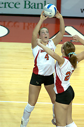 15 October 2005: Illinois State Redbird Erin Lindsey (4) set up the ball for a short slam by Kari Staehlin. The Fighting Irish of Notre Dame knocked out the Illinois State Redbirds in 4 games.  The match was filled with several action packed vollies. A resonable fan base was on hand for this rare Monday evening competition at Redbird Arena on the campus of Illinois State University in Normal IL