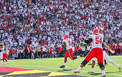Sep 4, 2021; College Park, Maryland, USA; Maryland Terrapins tight end Chigoziem Okonkwo (9) catches a pass and runs for a touchdown during the first quarter against the West Virginia Mountaineers at Capital One Field at Maryland Stadium. Mandatory Credit: Ben Queen-USA TODAY Sports