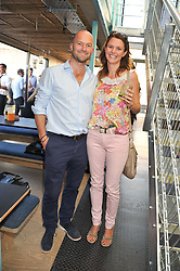 HUGH ROBERTSON and MELISSA HANBURY at a party to celebrate the opening of the Wahaca Southbank Experiment - a temporary restaurant made from 8 metal shipping containers, outside The Queen Elizabeth Hall, Southbank, London SE1 on 28th June 2012.