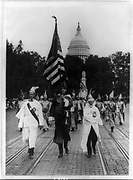 Parade of the Ku Klux Klan, in regalia and carrying the stars and stripes, through counties of Virginia bordering on the District of Columbia,  America, 1926.