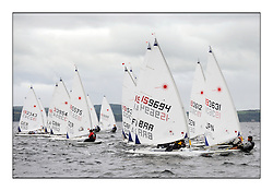 The second day of racing at the World Laser Radial Youth Championships, Largs, Scotland..Men's Yellow flight upwind with Stefano Mazzaferro BRA 159694 and Akira Hanada JPN 193631..317 Youth Sailors from 42 different nations compete in the World and European Laser Radial Youth Champiponship from the 17-25 July 2010...The Laser Radial World Championships take place every year. This is the first time they have been held in Scotland and are part of the initiaitve to bring key world class events to Britain in the lead up to the 2012 Olympic Games. ..The Laser is the world's most popular singlehanded sailing dinghy and is sailed and raced worldwide. ..Further media information from .laserworlds@gmail.com.event press officer mobile +44 7866 571932 and +44 1475 675129 .