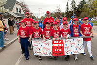 Laconia Little League's Jolly Jumpers majors team along with their coaches Ryan Corneau and Russ Schmitt march down North Main Street to Colby Field for the 2012 opening day ceremonies to be followed by games Saturday morning.   (Karen Bobotas/for the Laconia Daily Sun)