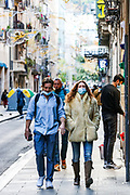 People wearing face protective surgical mask walk along with Ciutat Vella neighbourhood in the city centre of Barcelona on Sunday, Dec 6, 2020. As of December 5, official figures, which are now released daily on Epidemiologic monitoring website (dadescovid.cat), state there have been 349,305 confirmed Covid-19 cases (PCR tests and others including antibody tests). (VXP Photo/ Vudi Xhymshiti)