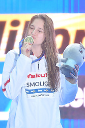 HANGZHOU, Dec. 15, 2018  Olivia Smoliga of the United States kisses the medal during Women's 50m Backstroke Final at 14th FINA World Swimming Championships (25m) in Hangzhou, east China's Zhejiang Province, on Dec. 15, 2018. Olivia Smoliga claimed the title with 25.88 seconds. (Credit Image: © Xinhua via ZUMA Wire)