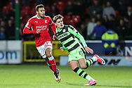 Forest Green Rovers Charlie Cooper(15) and Swindon Town's Keshi Anderson(30) during the EFL Trophy match between Swindon Town and Forest Green Rovers at the County Ground, Swindon, England on 5 December 2017. Photo by Shane Healey.