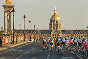 The lead group of cyclists enter Paris to finish the 100th Tour de France. Specialized Bicycle Components hosted a VIP experience for select media joining the last four stages of the 2013 Tour de France. Image by Greg Beadle Global sport and corporate event photography by Greg Beadle. Greg captures the energy and emotion of international events including the World Economic Forum, Tour de France, Cape Epic MTB and the Cape Town Cycle Tour