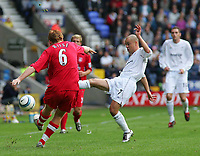 Photo. Andrew Unwin.<br /> Bolton Wanderers v Liverpool, Barclays Premiership, Reebok Stadium, Bolton 29/08/2004.<br /> Bolton's Stelios (R) looks to prevent Liverpool's John Arne Riise (L) from playing the ball upfield<br /> NORWAY ONLY