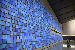 Sept. 4, 2014 - New York, New York, US - Visitors stand in front of a blue wall, by New York artist Spencer Finch, which remindes of the blue sky on the day of the terrorist attacks on 11 September 2001, at the 9/11 Museum in New York, USA, 4 September 2014. The museum commemorates the victims who died when the twin towers of the former World Trade Centre collapsed in the terrorist attacks. Photo:  Chris Melzer/dpa (Credit Image: © Chris Melzer/DPA/ZUMA Wire)