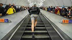 "© Licensed to London News Pictures. 12/01/2020. LONDON, UK. A participant takes part in ""No Trousers On The Tube Day"".  Now in its 11th year, the annual event sees hundreds of riders travel on the tube without wearing trousers.  Similar rides are taking place worldwide under the umbrella of ""No Pants Subway Ride"", which launched in New York in 2002.  Photo credit: Stephen Chung/LNP"
