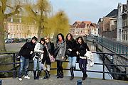 Gent, Belgie, Mar 14, 2009, Spanish tourists posing at The Lievekaai.