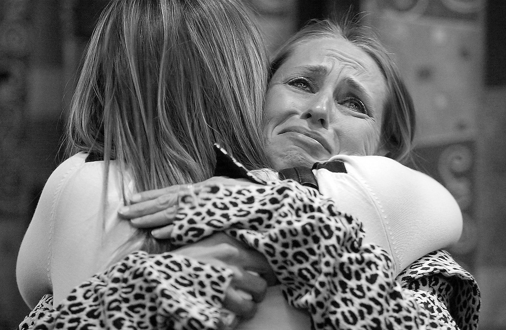 (110907  Boston, MA)   Military families who have lost loved ones gathered for a special viewing of a NECN production that is coming out for Veterans Day.   Nicole DiCenzo embraces Andrea Silva following the viewing.