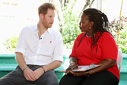 Prince Harry and councillor Ministry of Health HIV Program Susette Neblett-Straughn (right) talk on stage in prepartion of an live HIV test, at the 'Man Aware' event held by the Barbados National HIV/AIDS Commission in Bridgetown, Barbados, during his tour of the Caribbean.