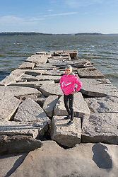 Joan Benoit Samuelson at Wolfe Neck cribstone jetty along her marathon training route near her home in Freeport Maine