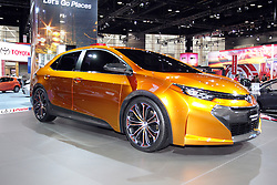 "08  February 2013: Toyota Corolla Furia concept car. Chicago Auto Show, Chicago Automobile Trade Association (CATA), McCormick Place, Chicago Illinois<br /> <br /> TOYOTA COROLLA FURIA CONCEPT: If you want a glimpse at what's hot and exciting in the next-generation of compact sedans, gaze at the Toyota Corolla Furia concept during the 2013 Chicago Auto Show. The Furia is fashioned around what Toyota designers call, ""Iconic Dynamism,"" which presents a provocative and dynamic exterior form. With its longer wheelbase (181.9 inches) the Corolla Furia Concept becomes a more stable and athletic vehicle, rolling on custom 19-inch allow wheels pushed to all four corners. As the show car slowly revolves, note the sinister-looking front fascia and blacked-out grille treatment that emphases a pair of sculpted front LED headlamps. In profile, this sexy sedan is topped by a sloped roofline and swept windshield. Pronounced fender flares heighten the carbon fiber pieces accenting the wheel wells, rocker panels and rear valance. Just as aggressive looking as the front, the rear section includes an attention-getting spoiler, composite LED taillight assemblies and ornate metal exhaust outlet surrounds that indicate a performance-tuned four-cylinder under the hood. Expect much of the concept's design language to influence the future Corolla production models, which by that time, 100% of Corolla's sold in the U.S. will be built in North America."