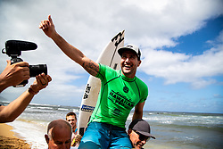 Joel Parkinson of Australia is chaired up the beach after winning the Hawaiian Pro at Haleiwa, Oahu, Hawaii, USA.