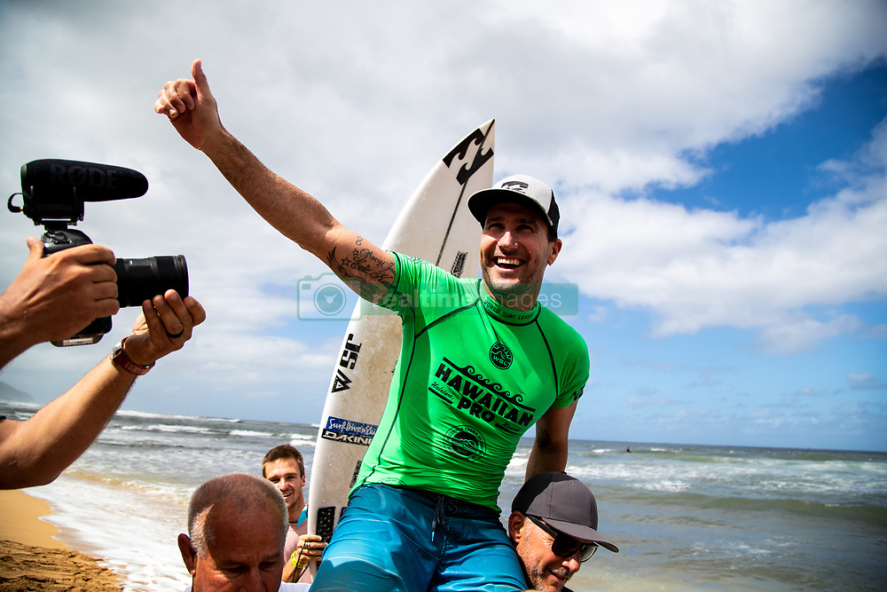 Joel Parkinson of Australia is chaired up the beach after winning the Hawaiian Pro at Haleiwa, Oahu, Hawaii, USA.