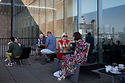 Members room terrace at Tate Modern gallery of contemporary art in London, England, United Kingdom. Tate Modern is based in the former Bankside Power Station in Southwark and is one of the largest museums of modern and contemporary art in the world. As with the UKs other national galleries and museums, there is no admission charge for access to the collection displays, which take up the majority of the gallery space. The redevelopment of the space was undertaken by architects Herzog & de Meuron.