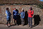Friends in a community walking group enjoy winter sunshine, on 25th February 2018, near Cudham, Kent, England.