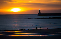 © Licensed to London News Pictures. 25/12/2015. Tynemouth, UK. Sunrise on Christmas day on Longhands beach in Tynemouth, north east England. Photo credit: Ben Cawthra/LNP
