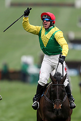 Jockey Robbie Power (centre) celebrates after his winning ride on Sizing John in the Timico Cheltenham Gold Cup Chase during Gold Cup Day of the 2017 Cheltenham Festival at Cheltenham Racecourse.