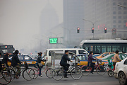 Cyclists and traffic on Beijing main street, Chang An Avenue, China