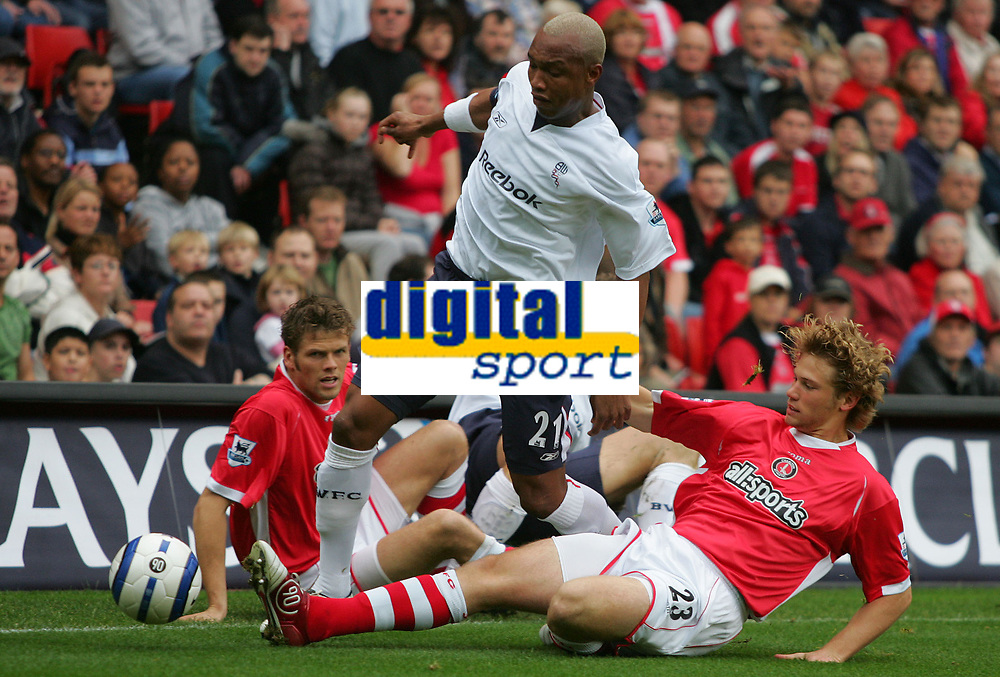Photo: Frances Leader.<br />Charlton Athletic v Bolton Wanderers. The Barclays Premiership. 29/10/2005.<br /><br />Bolton's El Hadji Diouf is tackled by Charlton's Jonathan Spector.
