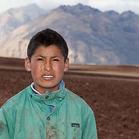 A boy posing near his farm, somewhere between Moray and Maras Village.