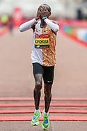 Eliud Kipchoge (Kenya) holds his face as he wins the Men's Elite race in the Virgin Money 2019 London Marathon, London, United Kingdom on 28 April 2019.