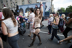"""© licensed to London News Pictures. 11/06/2011. London, UK. Thousands of Women take to the streets of London today (11/06/2011) to take part in Slutwalk. Slutwalk was started following remarks made by a Canadian police officer, who advised women """"to avoid dressing as sluts"""" if they did not want to be harassed Please see special instructions for usage rates. Photo credit should read Ben Cawthra/LNP"""