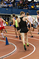 NSAF 2014 New Balance Nationals Indoor, boys two-mile, Dan Curts inspects shoulder he fell on at start of race